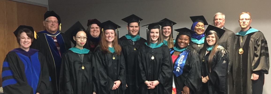 MPA graduates in cap and gowns