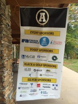 banner listing the golf tournament sponsors